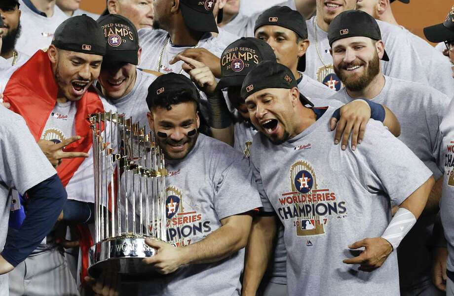 Houston Astros second baseman Jose Altuve (27) holds the World Series trophy as the Astros celebrate beating the Los Angeles Dodgers 5-1 in Game 7 of the World Series at Dodger Stadium on Wednesday, Nov. 1, 2017, in Los Angeles. Photo: Brett Coomer / Houston Chronicle / © 2017 Houston Chronicle