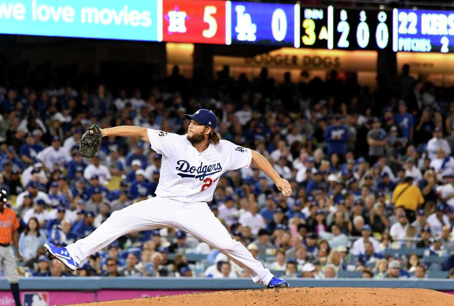 The Los Angeles Dodgers' Clayton Kershaw comes on in relief against the Houston Astros in the third inning during Game 7 of the World Series at Dodger Stadium in Los Angeles on Wednesday, Nov. 1, 2017. Photo: Wally Skalij / TNS / Los Angeles Times