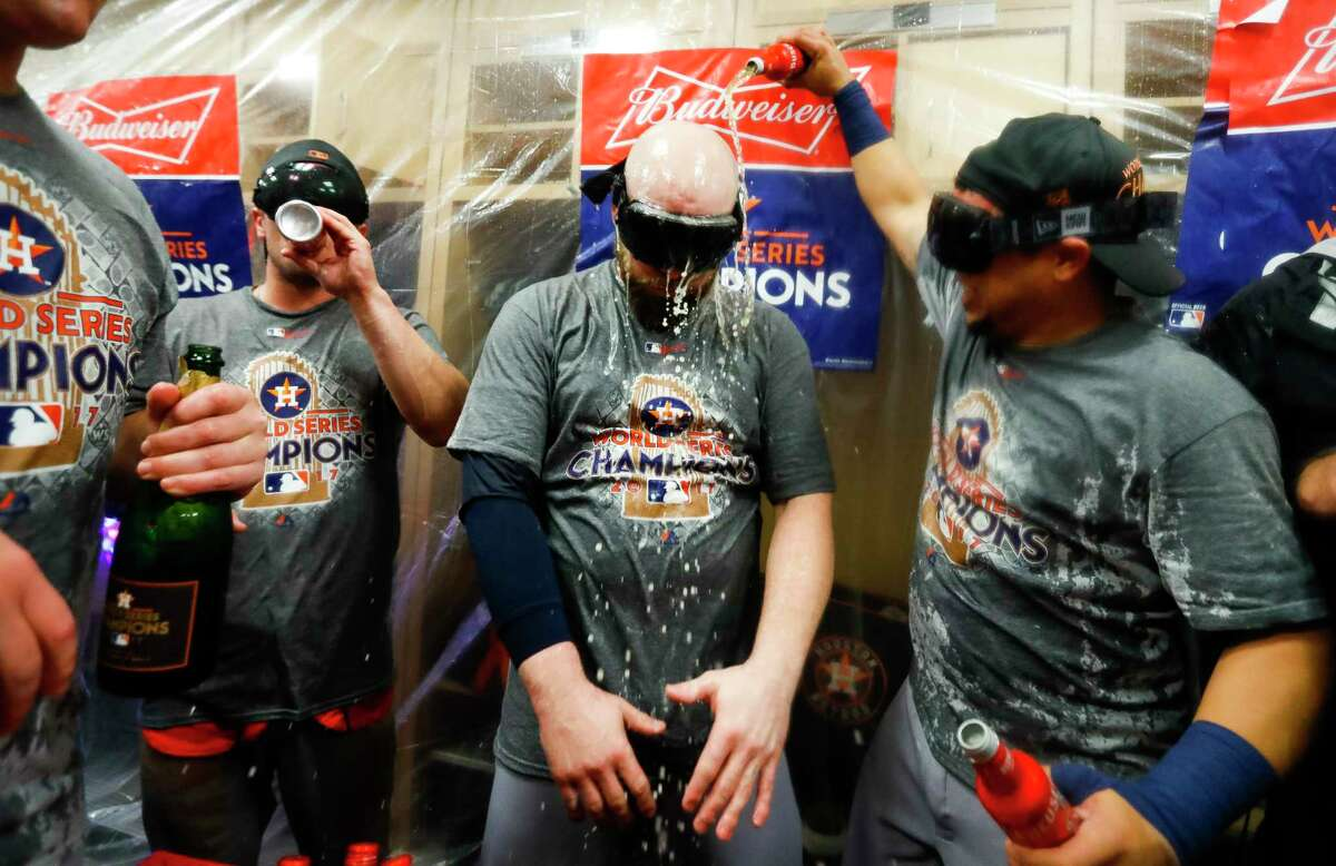The Astros celebrate their World Series win in the locker room after Game 7 of the World Series at Dodger Stadium on Wednesday, Nov. 1, 2017, in Los Angeles.