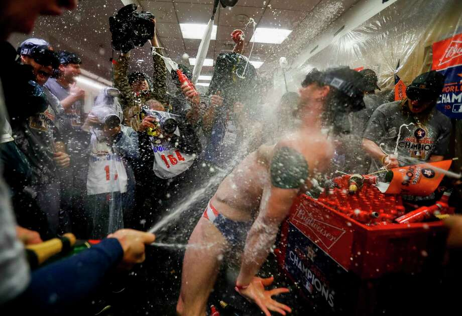 Houston Astros right fielder Josh Reddick (22) celebrates in the Astros locker room after the team won the World Series in Game 7 of the World Series at Dodger Stadium on Wednesday, Nov. 1, 2017, in Los Angeles. Photo: Karen Warren, Houston Chronicle / © 2017 Houston Chronicle