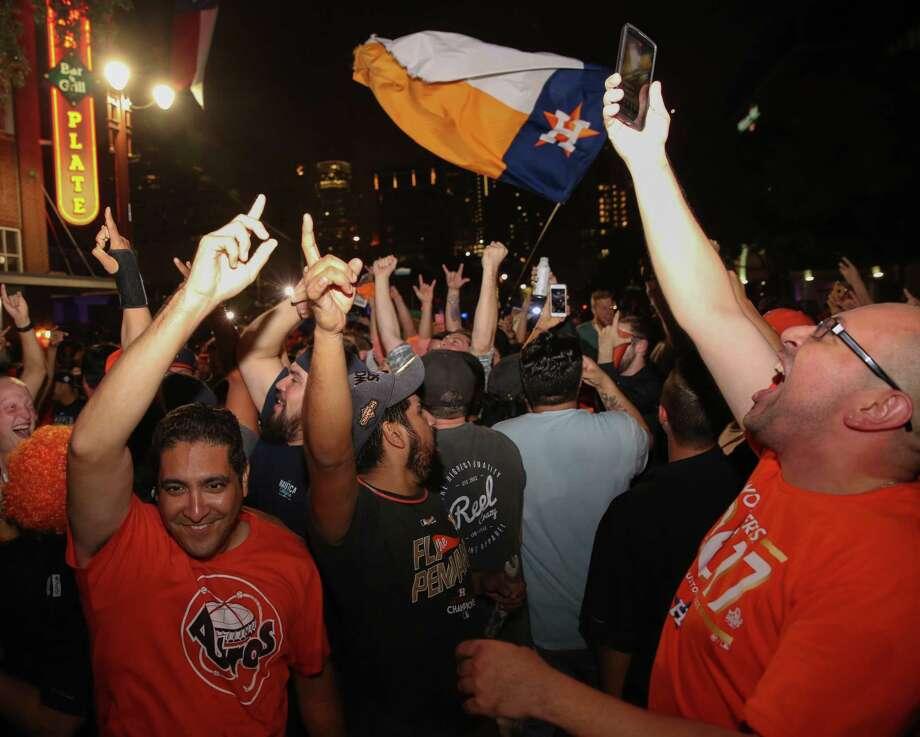 Houston Astros fans take it onto Texas Avenue as the Houston Astros won the World Series Championship on Wednesday, Nov. 1, 2017, in Houston. Photo: Yi-Chin Lee, Houston Chronicle / Houston Chronicle