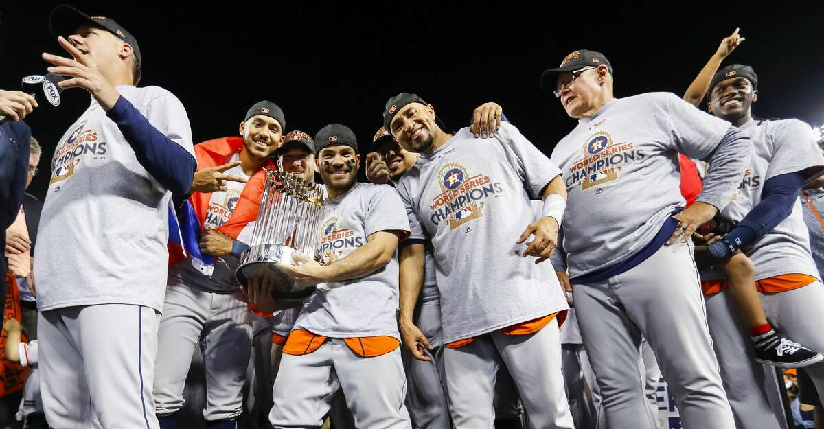 Houston Astros second baseman Jose Altuve (27) holds the trophy after the Astros won the World Series in Game 7 of the World Series at Dodger Stadium on Wednesday, Nov. 1, 2017, in Los Angeles. ( Karen Warren / Houston Chronicle )