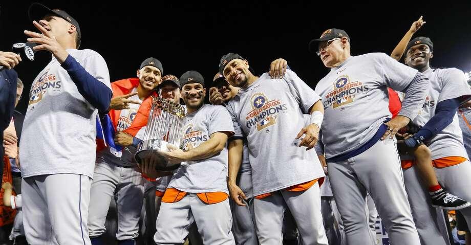 Jose Altuve, avatar of Houston, holds the Series trophy. Photo: Karen Warren/Houston Chronicle