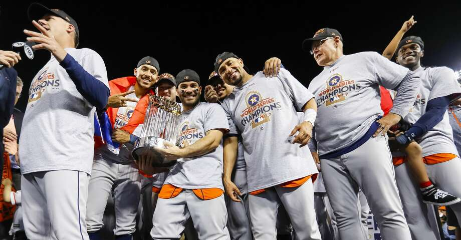 Houston Astros second baseman Jose Altuve (27) holds the trophy after the Astros won the World Series in Game 7 of the World Series at Dodger Stadium on Wednesday, Nov. 1, 2017, in Los Angeles. ( Karen Warren / Houston Chronicle ) Photo: Karen Warren/Houston Chronicle
