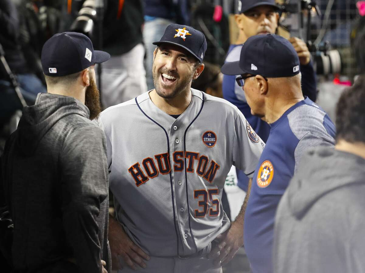 Houston Astros starting pitcher Justin Verlander (35) laughs in the dugout after the end of the sixth inning of Game 6 of the World Series at Dodger Stadium on Tuesday, Oct. 31, 2017, in Los Angeles. ( Karen Warren / Houston Chronicle )