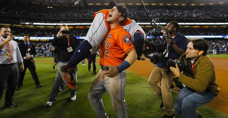 Houston Astros third baseman Alex Bregman (2) picks up second baseman Jose Altuve (27) after the Astros win the World Series in Game 7 of the World Series at Dodger Stadium on Wednesday, Nov. 1, 2017, in Los Angeles. ( Karen Warren / Houston Chronicle ) Photo: Karen Warren/Houston Chronicle