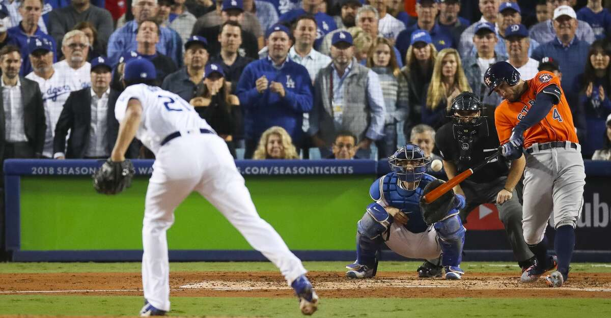 Houston Astros center fielder George Springer (4) hits a two-run home run during the second inning of Game 7 of the World Series at Dodger Stadium on Wednesday, Nov. 1, 2017, in Los Angeles. ( Michael Ciaglo / Houston Chronicle )