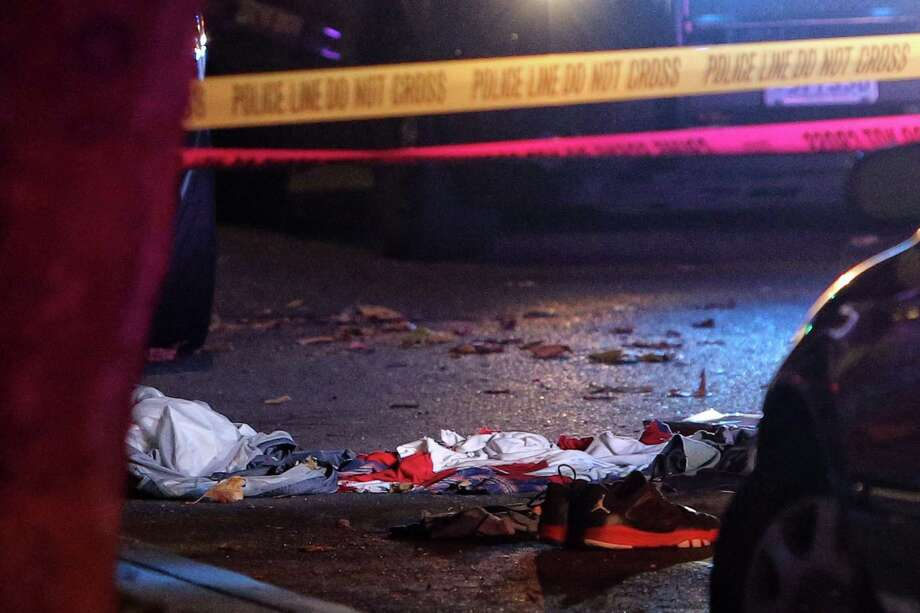 Shoes and clothing are seen as police investigate the scene of a shooting at 5th and Battery Street that occurred just after midnight, Thursday, Nov. 2, 2017. Two of the three victims were killed and the third was taken to Harborview Medical Center for treatment of his injuries.Prosecutors say one of the two men involved in the shooting was nabbed near the Mexican 