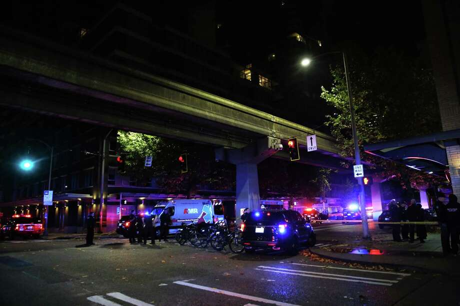 Police investigate the scene of a shooting at 5th and Battery Street that occurred just after midnight, Thursday, Nov. 2, 2017. Two of the three victims have been confirmed dead, the third was taken to Harborview Medical Center. All victims were approximately in their mid-20s. Photo: GENNA MARTIN, SEATTLEPI / SEATTLEPI.COM