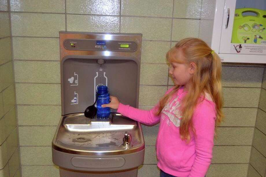 Sarah Boyer, a third grade student at Christ the King, is enjoying filling her water bottle at one of the three new fountains. (Submitted Photo)