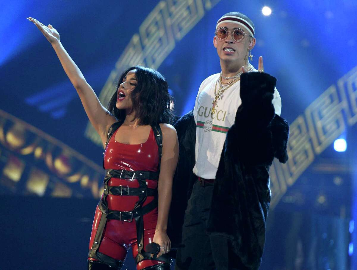 Becky G, left, and Bad Bunny perform