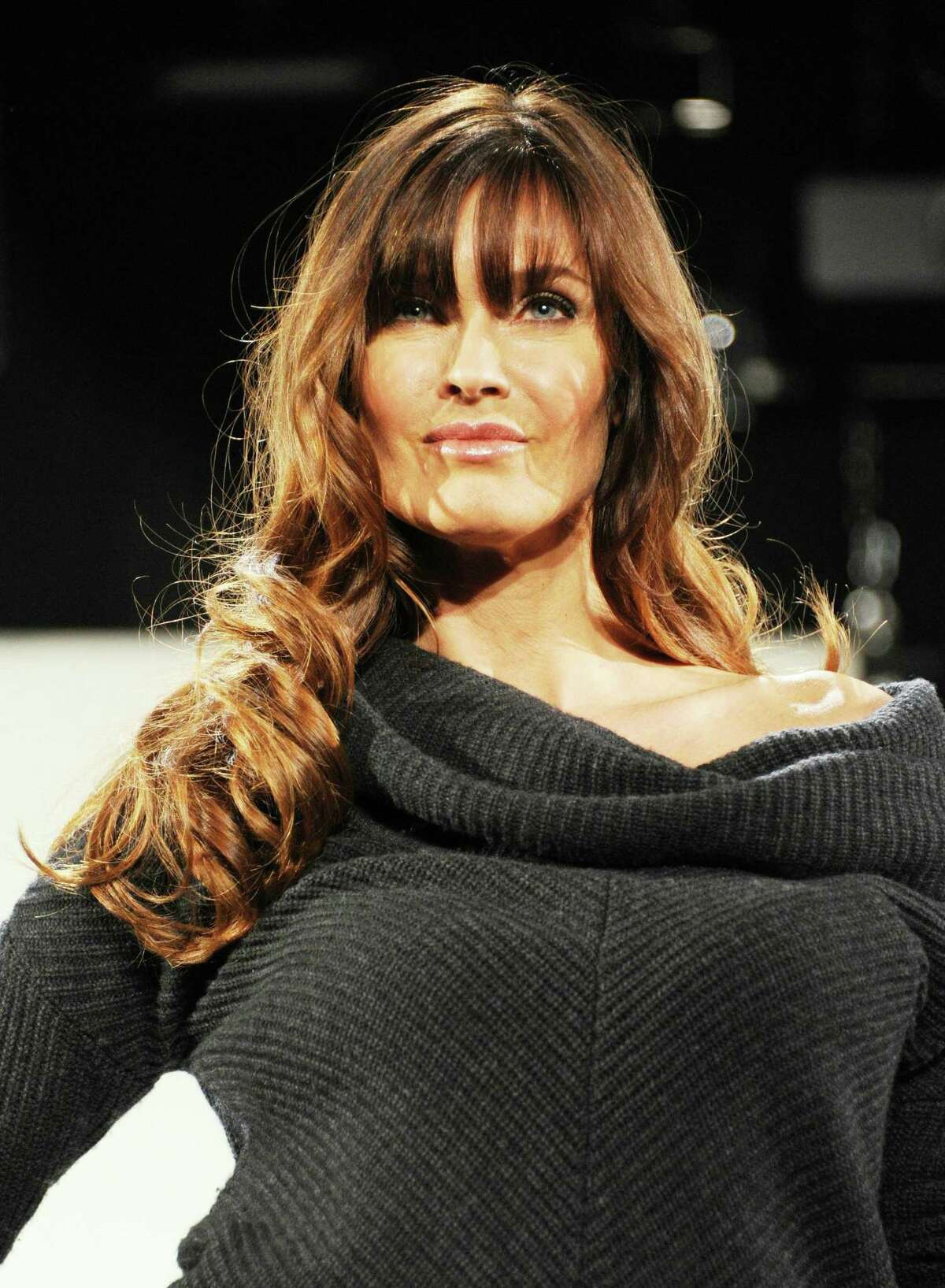 NEW YORK, NY - FEBRUARY 16: Model Carol Alt walks the runway during the Vittadini Fall 2011 presentation during Mercedes-Benz Fashion Week at The Box at Lincoln Center on February 16, 2011 in New York City. (Photo by Mike Coppola/Getty Images For IMG)