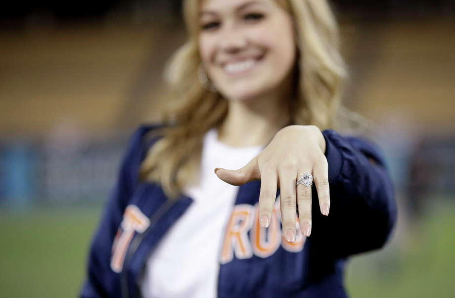 Daniella Rodriguez, former Miss Texas shows off her engagement ring after Houston Astros shortstop Carlos Correa purposed after Game 7 of baseball's World Series Wednesday, Nov. 1, 2017, in Los Angeles. The Astros won 5-1 to win the series 4-3 against the Los Angeles Dodgers. (AP Photo/Jae C. Hong) Photo: Jae C. Hong, Associated Press / Copyright 2017 The Associated Press. All rights reserved.