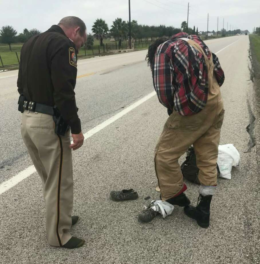 Fort Bend County Sheriff Troy Nehls is seen giving his work boots to another man on Wednesday, Nov. 1, 2017. Photo: Mark Duran/Facebook