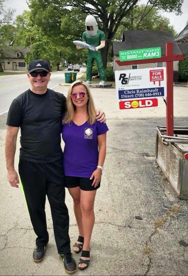 New owners Tully Garrett, left, and Holly Barker stand outside the Gemini Giant/Launching Pad on Route 66 in WIlmington, Ill. Photo: For The Edge
