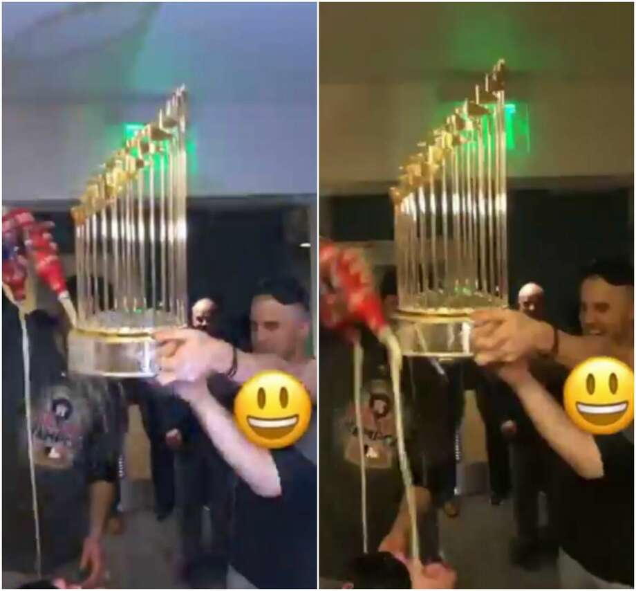 Houston Astros pitcher James Hoyt and catcher Max Stassi had a little fun Wednesday night with the Commissioner's Trophy.Swipe through to see more locker room shenanigans following the team's World Series win. Photo: TMZ