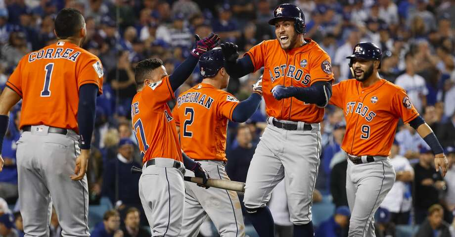 Houston Astros shortstop Carlos Correa (1), second baseman Jose Altuve and third baseman Alex Bregman celebrate center fielder George Springer's (4) two-run home run that drove in left fielder Marwin Gonzalez (9) during the second inning of Game 7 of the World Series at Dodger Stadium on Wednesday, Nov. 1, 2017, in Los Angeles.  ( Karen Warren  / Houston Chronicle ) Photo: Karen Warren/Houston Chronicle