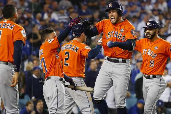 Houston Astros shortstop Carlos Correa (1), second baseman Jose Altuve and third baseman Alex Bregman celebrate center fielder George Springer's (4) two-run home run that drove in left fielder Marwin Gonzalez (9) during the second inning of Game 7 of the World Series at Dodger Stadium on Wednesday, Nov. 1, 2017, in Los Angeles.  ( Karen Warren  / Houston Chronicle )
