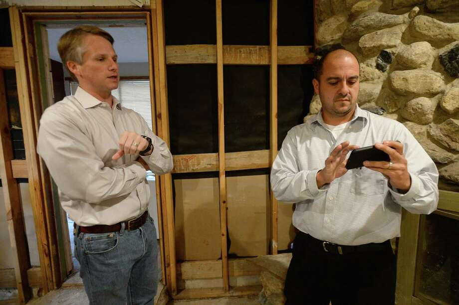 Jeremy Raley (right) talks with attorney Cade Bernsen, whose firm is handling the lawsuit being filed by residents in Vidor's Wexford Park subdivision against The Army Corps of Engineers. The suit cites the Corps' release of Dam B as the cause of the flooding that damaged all of the homes in the neighborhood. They are seeking compensation for the damages they suffered and the repair costs that they have incurred. Photo taken Wednesday, November 1, 2017 Kim Brent/The Enterprise Photo: Kim Brent, Beaumont Enterprise / BEN