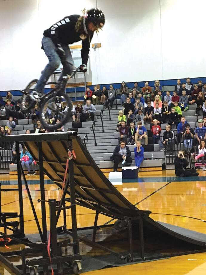 Liberty Middle School students enjoy a bicycle stunt show. The students in attendance were being rewarded for their fundraising efforts. Students were rewarded for selling items and received prizes for raising the most money. The top seller earned VIP seats to the show as well as a television and cash. Photo: John Sommerhof • Jsommerhof@edwpub.net