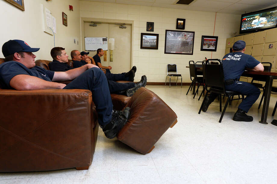 Firefighters watch Game 7 of the World Series at Beaumont Fire-Rescue's Station No. 1 on Wednesday night.   Photo taken Wednesday 11/1/17 Ryan Pelham/The Enterprise Photo: Ryan Pelham / ©2017 The Beaumont Enterprise/Ryan Pelham
