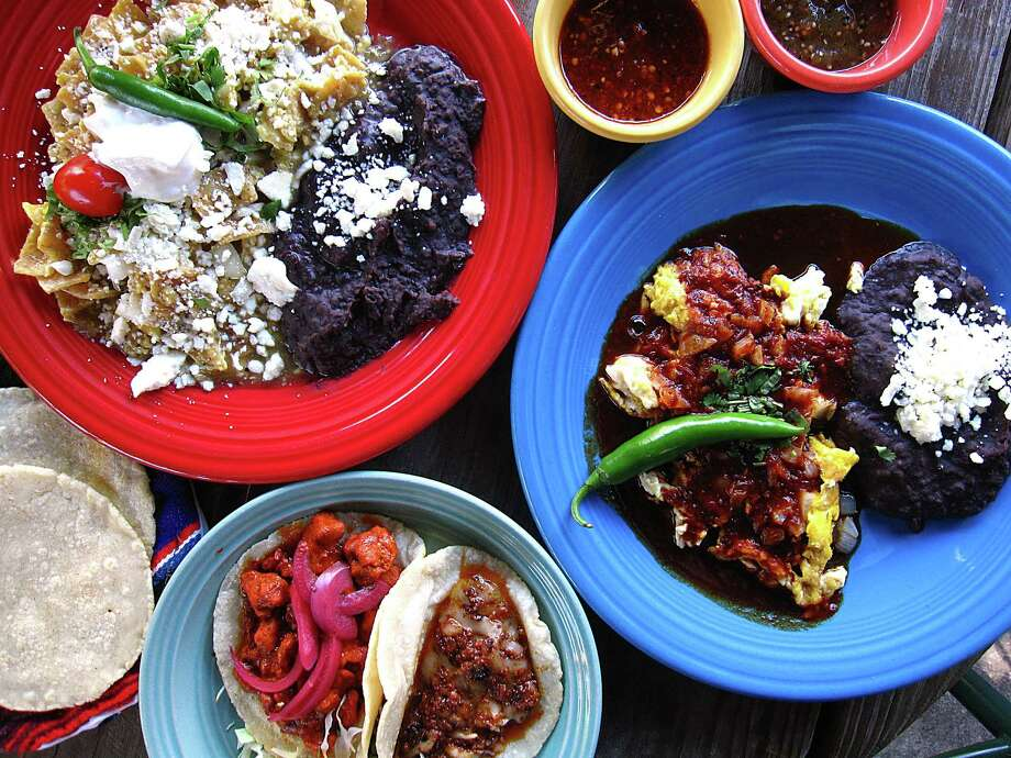 Clockwise from top left: Chilaquiles, salsa, Cascabel eggs, tacos and tortillas from Cascabel Mexican Patio. Photo: Mike Sutter /San Antonio Express-News