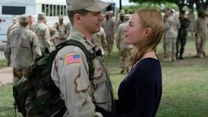 "One of ""The Long Road Home's"" compelling love and war stories: Jason Ritter portrays Capt.Troy Denomy and Kate Bosworth is his wife, Gina Denomy, on the Texas set of the series, Fort Hood in Killeen, where all eight hours were filmed."
