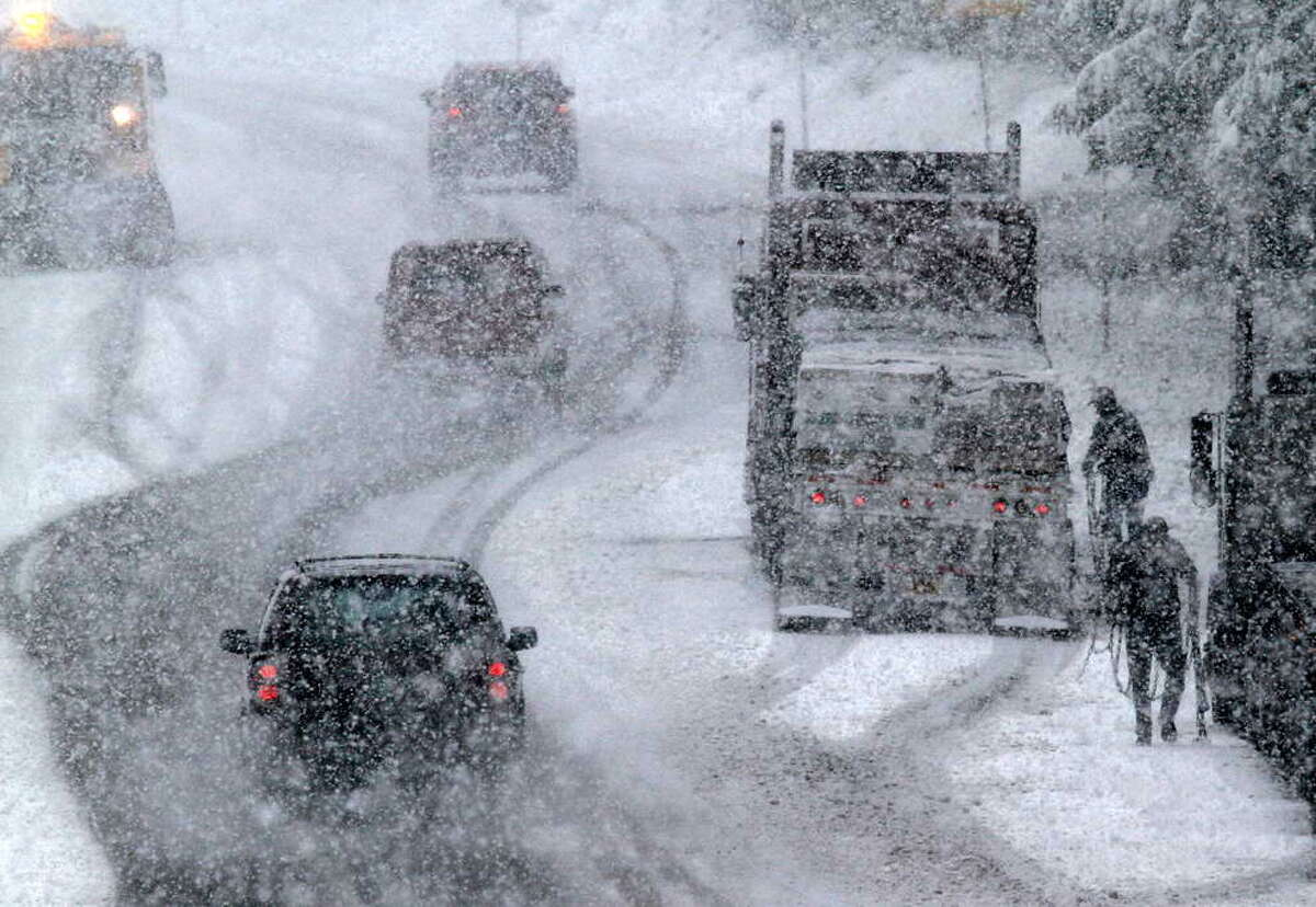 FILE photo: Snow conditions spur chain control on a highway in the Sierra Nevada.
