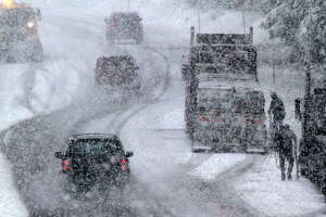 Snow conditions spur chain control on a highway in the Sierra Nevada.