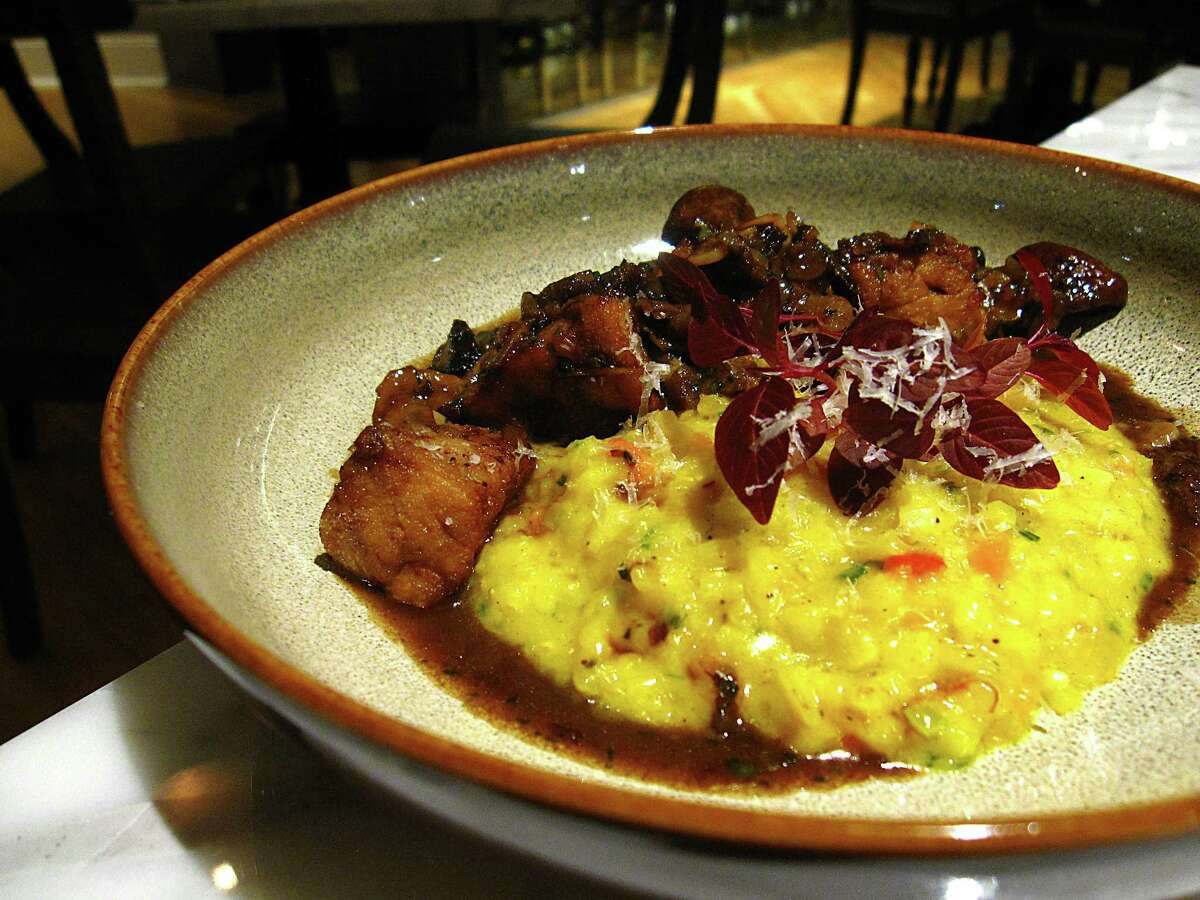 Risotto & Animelle with saffron risotto, mushrooms and fried sweetbreads from Nonna Osteria.