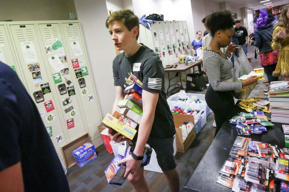 The John Cooper School freshman Zachary Winton carries supplies for military care packages during the Cooper Cares Day on Tuesday, Oct. 31, 2017, at The John Cooper School. Photo: Michael Minasi, Staff Photographer / © 2017 Houston Chronicle
