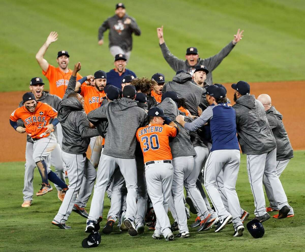 The Houston Astros celebrate beating the Los Angeles Dodgers 5-1 in Game 7 of the World Series at Dodger Stadium on Wednesday, Nov. 1, 2017, in Los Angeles. The Astros took the Series 4-games-to-3 to capture the franchise's first title.