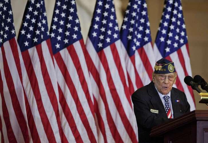 Celestino Almeda, a Filipino World War II veteran, speaks during a ceremony at the U.S. Capitol.