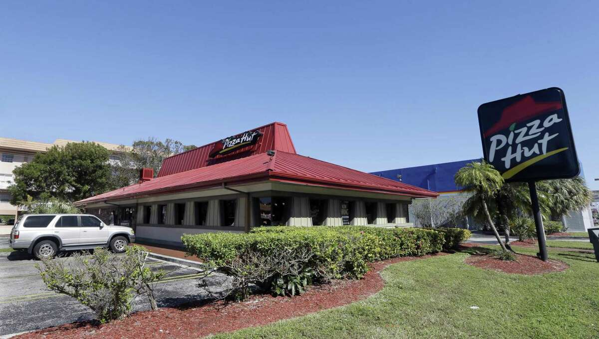 Customers park at a Pizza Hut in Miami. Yum Brands, Inc. saw a key sales measure rise at KFC, Pizza Hut and Taco Bell for the third quarter. Sales rose 1 percent at Pizza Hut's established locations, but all of that growth came from restaurants outside of the United States.