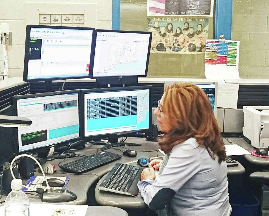Eemergency dispatcher Maria Lobo at work in the town's Emergency Communications Center, located in the basement of the Police Department. Town officials are looking at a proposal that would merge Fairfield and Westport dispatchers into one location. Photo: File Photo / Fairfield Citizen