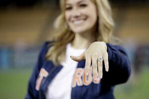 Daniella Rodriguez, former Miss Texas shows off her engagement ring after Houston Astros shortstop Carlos Correa purposed after Game 7 of baseball's World Series Wednesday, Nov. 1, 2017, in Los Angeles. The Astros won 5-1 to win the series 4-3 against the Los Angeles Dodgers. (AP Photo/Jae C. Hong)
