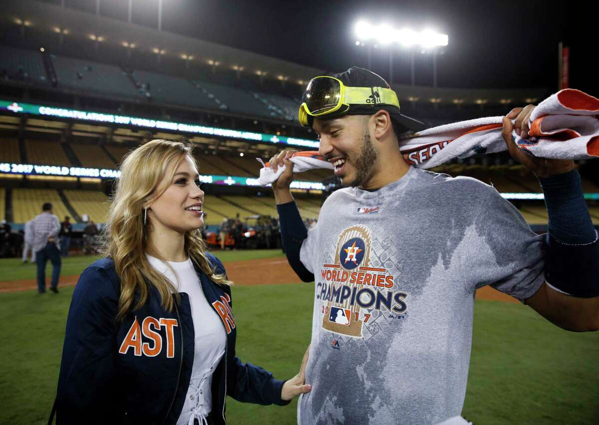 Daniella Rodriguez, former Miss Texas, talks to Houston Astros' Carlos Correa after Game 7 of baseball's World Series Wednesday, Nov. 1, 2017, in Los Angeles. The Astros won 5-1 to win the series 4-3. Correa proposed to Rodriguez after the game. (AP Photo/Jae C. Hong)