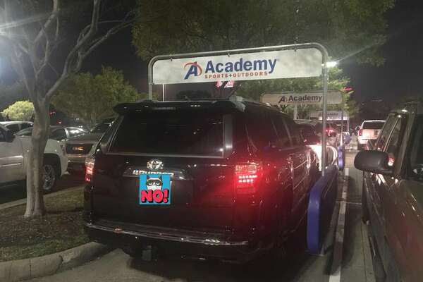 new york 9c6ab 6a8d9 Astros fan parks SUV in shopping cart rack in Academy ...