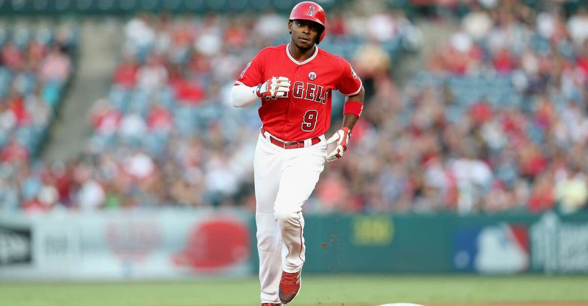 ANAHEIM, CA - SEPTEMBER 16: Justin Upton 9 of the Los Angeles Angels of Anaheim rounds second base after hitting a solo home run in the first inning against the Texas Rangers on September 16, 2017 at Angel Stadium of Anaheim in Anaheim, California. (Photo by Stephen Dunn/Getty Images)