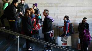 People wait in line before a public hearing on the city budget, Wednesday, Nov. 1, 2017 at City Hall. Hundreds of housing activists turned up on the second anniversary of the City declaring the homelessness crisis a Civil State of Emergency, to protest the homeless camp sweeps and call for solutions to the crisis. Activists camped overnight on the City Hall plaza and in the Bertha Knight Landis room.