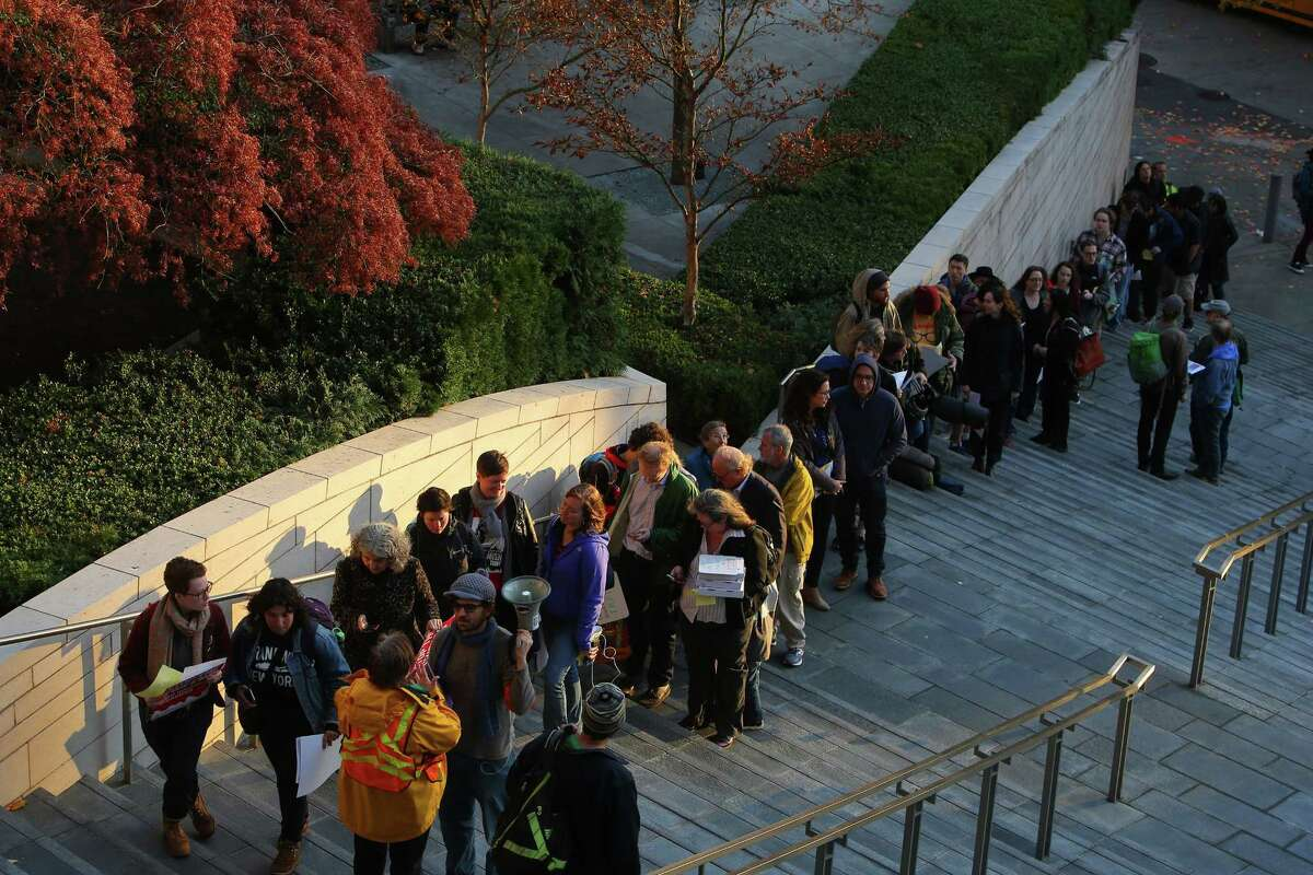 People wait in line before a public hearing on the city budget, Wednesday, Nov. 1, 2017 at City Hall. Hundreds of housing activists turned up on the second anniversary of the City declaring the homelessness crisis a Civil State of Emergency, to protest the homeless camp sweeps and call for solutions to the crisis. Activists set up tents and camped overnight on the City Hall plaza and in the Bertha Knight Landis room.
