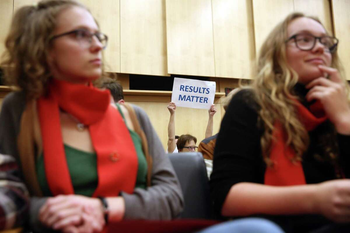 People hold up signs in Council Chambers during a public hearing on the city budget, Wednesday, Nov. 1, 2017 at City Hall. Hundreds of housing activists turned up on the second anniversary of the City declaring the homelessness crisis a Civil State of Emergency, to protest the homeless camp sweeps and call for solutions to the crisis. Activists set up tents and camped overnight on the City Hall plaza and in the Bertha Knight Landis room.