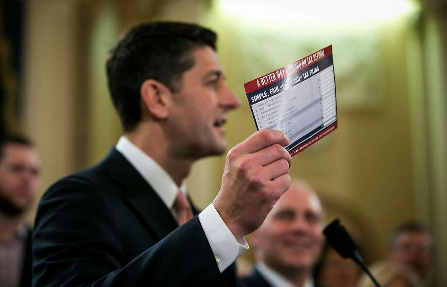 "Speaker of the House Paul Ryan holds up an example of what a ""postcard"" tax return might look like on Capitol Hill. Photo: AL DRAGO, NYT"