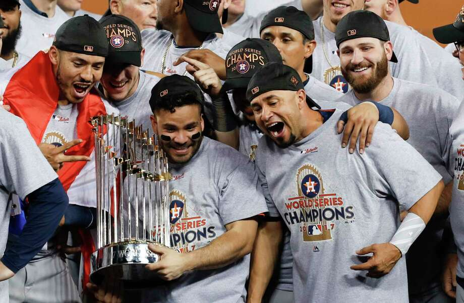 The Astros' World Series documentary includes a visit to the home of American League MVP Jose Altuve (holding trophy). Photo: Brett Coomer, Staff / © 2017 Houston Chronicle