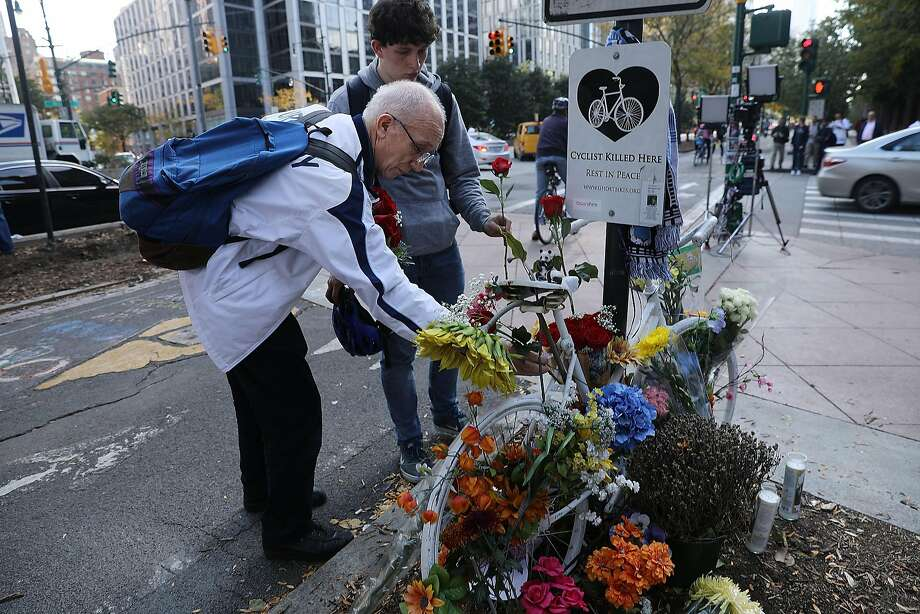 People place flowers at a memorial at the scene of Tuesday's terrorist attack along a bike path in lower Manhattan in New York City. Eight people were killed and 12 were injured. Photo: Spencer Platt, Getty Images