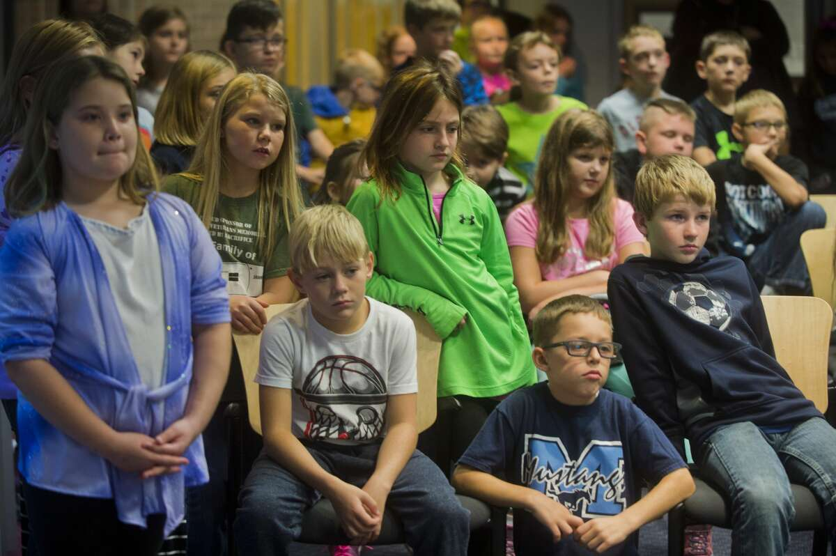 Meridian 4th graders listen as a few of their classmates present their suggested improvements for Sanford Lake Park to the Midland County Board of Commissioners on Oct. 17, 2017 in the County Services Building. (Katy Kildee/kkildee@mdn.net)