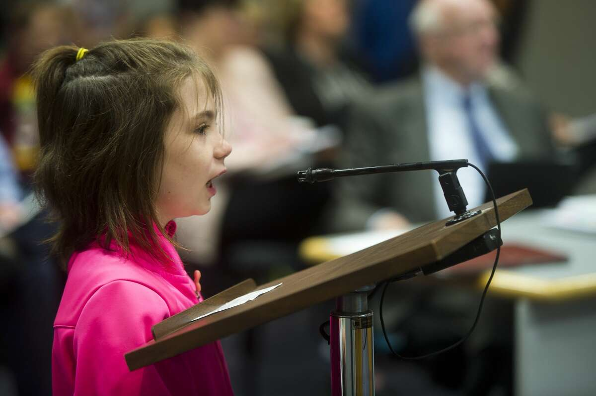 Meridian 4th grader Lyllyhanna Beaty presents her suggested improvements for Sanford Lake Park to the Midland County Board of Commissioners on Oct. 17, 2017 in the County Services Building. (Katy Kildee/kkildee@mdn.net)