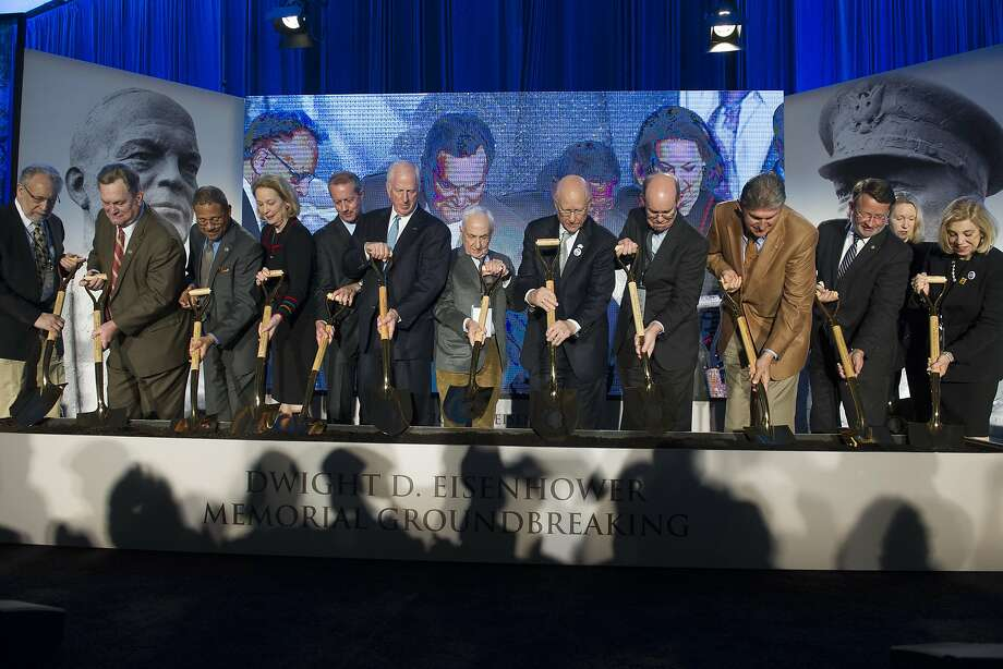 Architect Frank Gehry (center) joins Eisenhower family members in the ceremonial groundbreaking. Photo: Cliff Owen, Associated Press