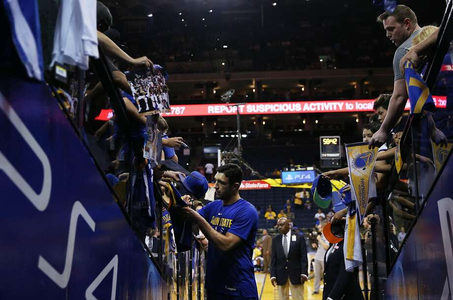 Golden State Warriors center Zaza Pachulia (27) signs autographs before an NBA game between the Golden State Warriors and Toronto Raptors at Oracle Arena on Wednesday, Oct. 25, 2017, in Oakland. Photo: Santiago Mejia, The Chronicle