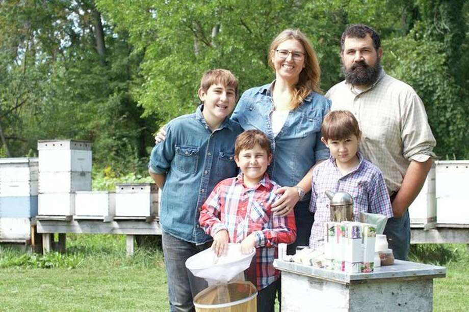 Unionville-based couple Josh and Jodie Kieliszewski have built a thriving business from the hive up with good, old-fashioned hard work and a grassroots marketing campaign. (photo provided)